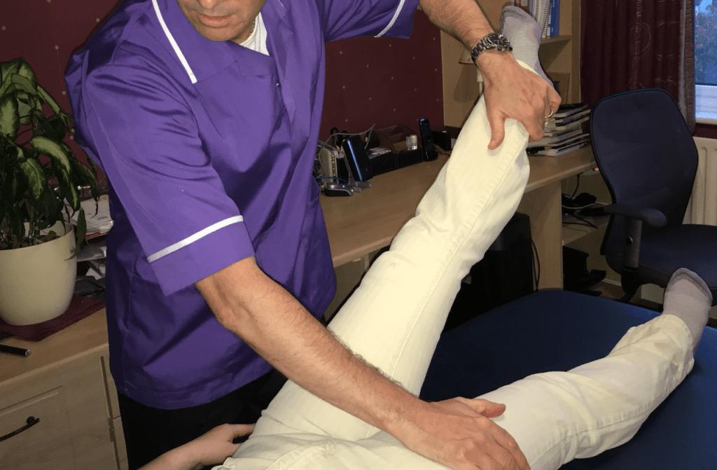 Simon Lawton performing muscle test of Psoas